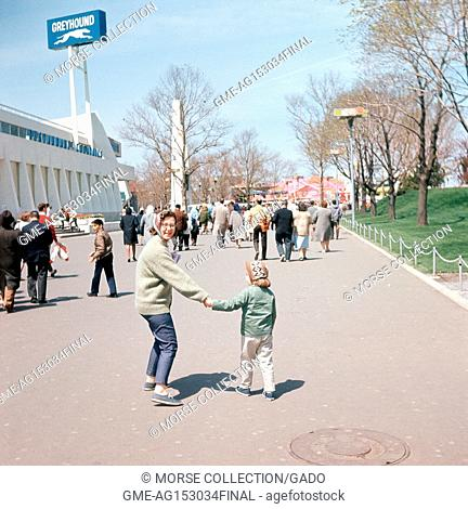 View facing northwest of visitors walking the Avenue of Transportation, at the New York World's Fair in Flushing Meadows-Corona, Queens, New York, May, 1965