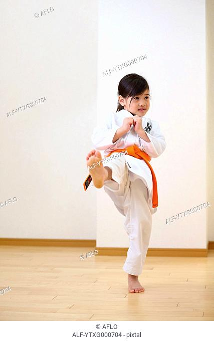 Japanese kid in karate uniform training