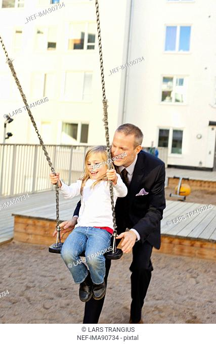Father and daughter playing in playground