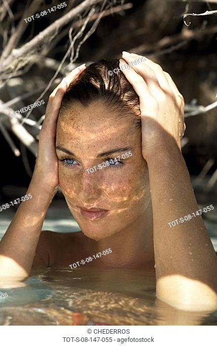 Close-up of a young woman washing her head