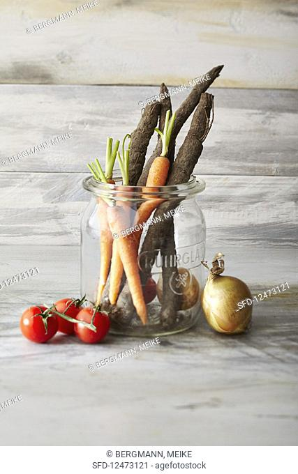 Fresh vegetables: tomatoes, carrots, black salsify and onions