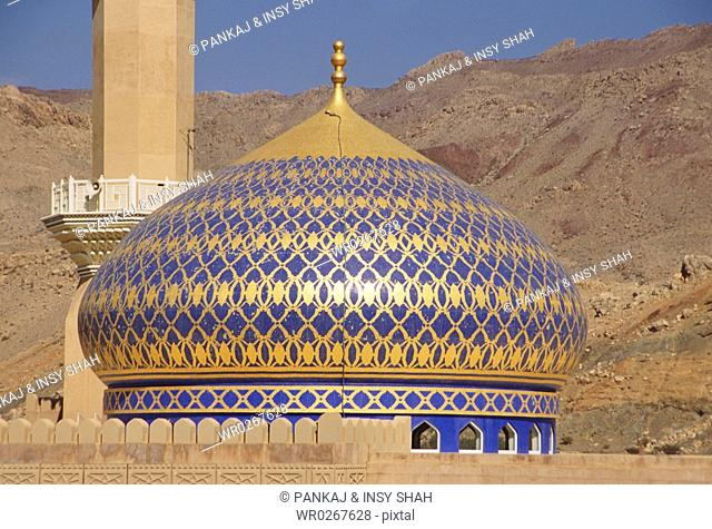 Dome of a mosque is seen against the landform