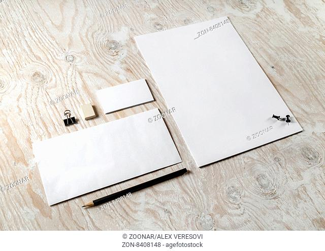 Blank stationery and corporate identity set on light wooden background. Mock-up for graphic designers portfolios. Top view