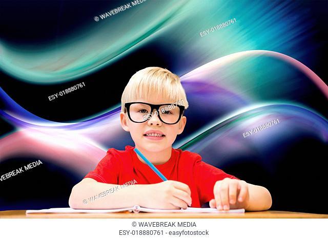 Composite image of cute pupil at desk