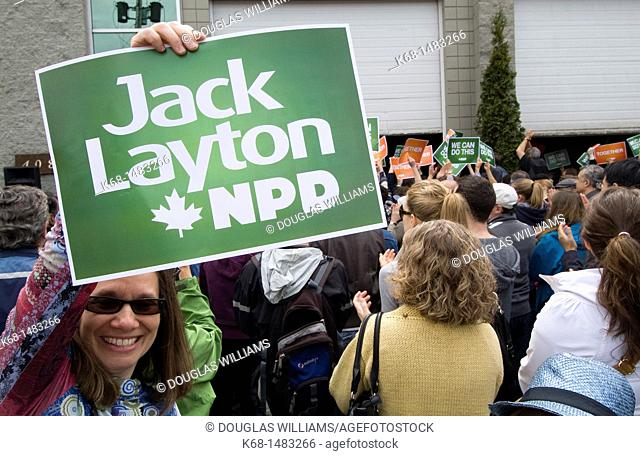 A woman holds a sign at a political rally for the New Democratic Party, NDP, before the federal election in Canada, 2011, in Burnaby, British Columbia, Canada