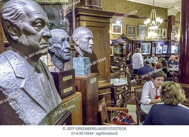 Argentina, Buenos Aires, Cafe Tortoni, landmark, iconic coffeehouse, restaurant, interior, tables, decor, statue, bust, Borges, woman, Hispanic