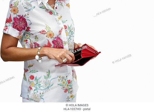 Mid section view of a woman holding her empty wallet