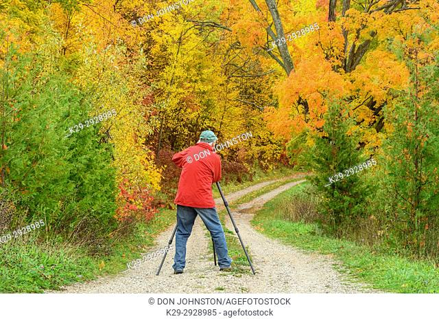 Photographing a laneway in autumn, Townline Road, Manitoulin Island, Ontario, Canada