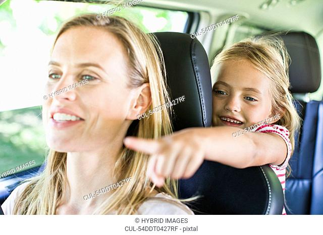 Mother and daughter talking in car