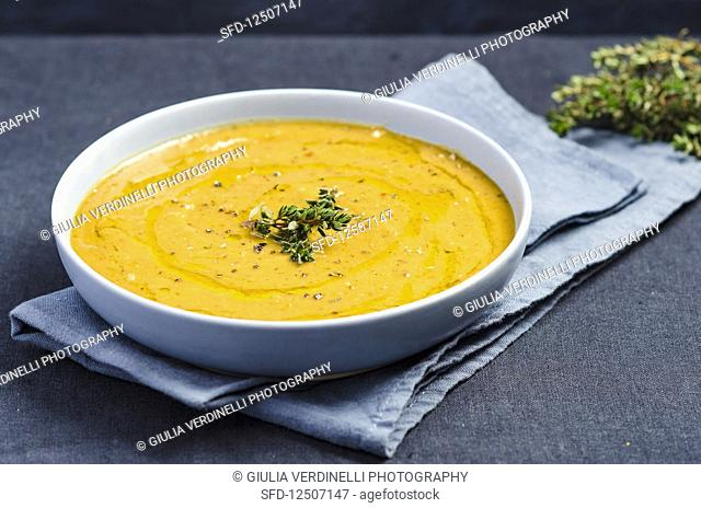 Cream of pumpkin sauce with thyme, olive oil and coarsely ground pepper