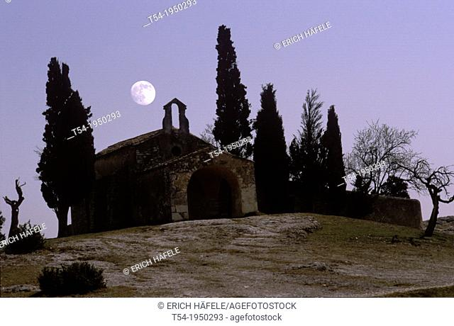 Full moon over a small chapel in southern France