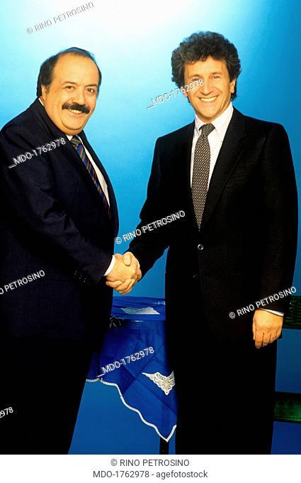 Maurizio Costanzo shaking the hand of Mino Damato. Italian Buona Domenica TV host Maurizio Costanzo shaking hands with Italian Domenica In TV presenter Mino...