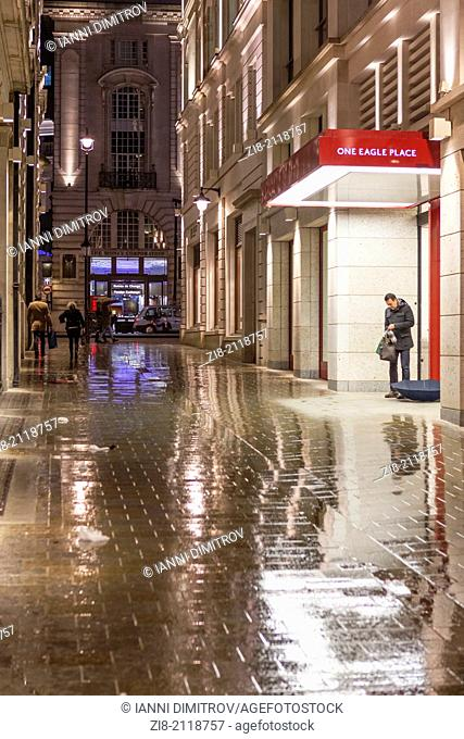 Eagle Place leading to Piccadilly after a heavy reain at night,London,England