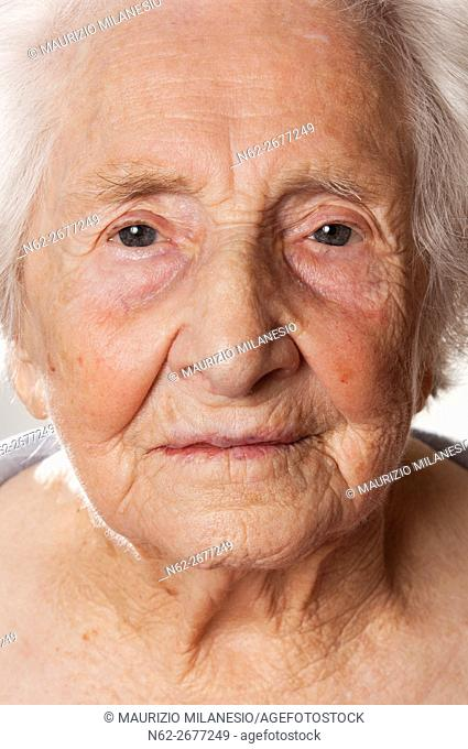 frontal view of the face of an elderly woman
