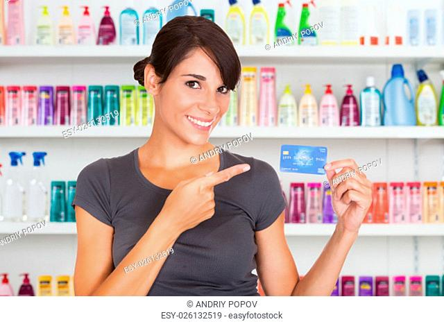 Happy Woman Holding Credit Card Over White Background