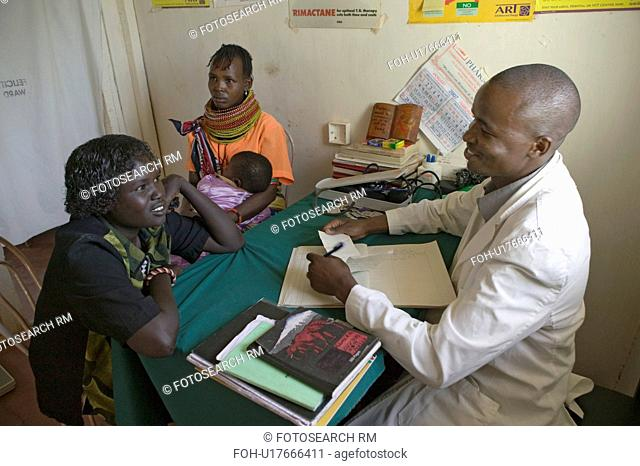 A doctor consults with mother and children about HIV/AIDS at Pepo La Tumaini Jangwani, HIV/AIDS Community Rehabilitation Program, Orphanage & Clinic