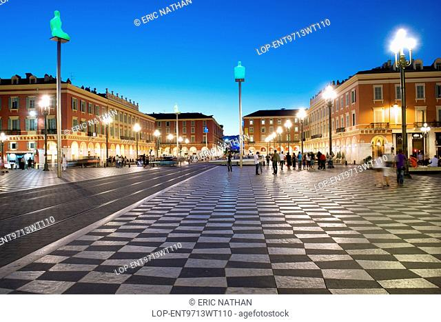 France, Provence Alpes Cote dAzur , Nice. A dusk view of the Place Massena and Galeries Lafayette in Nice