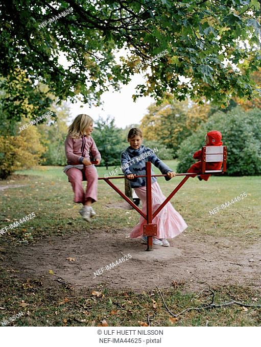 Three girls playing in a playground, Sweden