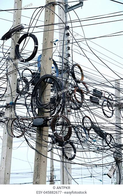 messy electrical cables on pole