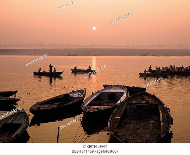 Boats on Ganges River at sunset, Varanasi, India