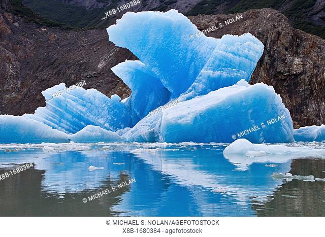 Glacial iceberg from ice calved off the South Sawyer Glacier in Tracy Arm, Southeast Alaska, USA, Pacific Ocean