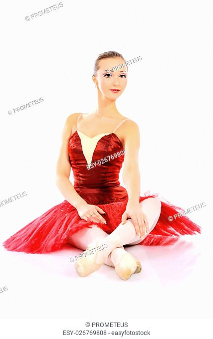Professional bellet dancer posing at studio. Isolated over white background