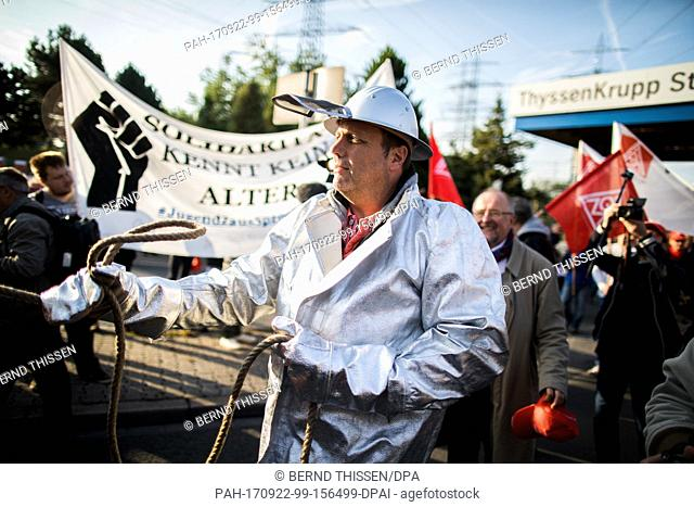An employee wears his protective clothing during a protest organised by the worker's council and the IG Metall union in Bochum, Germany, 22 September 2017