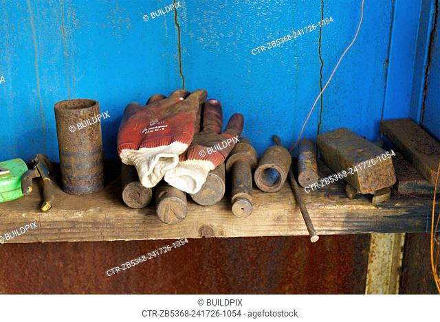 Gloves and steel objects in construction yard
