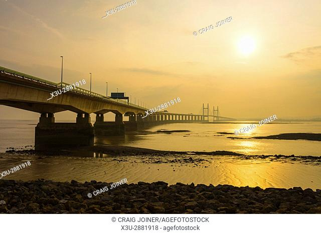 The Second Severn Crossing during a hazy sunset over the Severn Estuary viewed from Severn Beach, Gloucestershire, England
