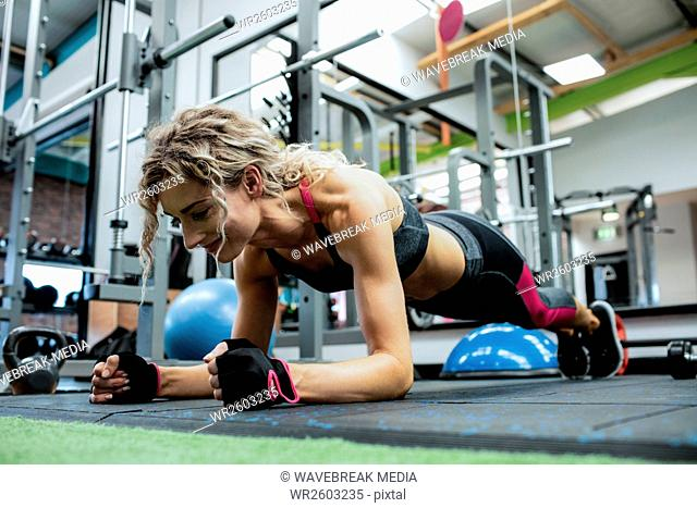 Woman performing push-up exercise