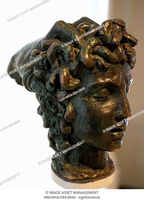 Bronze head of Medusa by Benvenuto Cellini (1500-1671) an Italian goldsmith, sculptor, draftsman, soldier, musician, and artist. Dated 16th Century