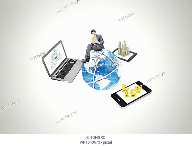 a business man sitting on the globe