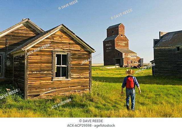a man hikes through the abandoned town of Bents, Saskatchewan, Canada