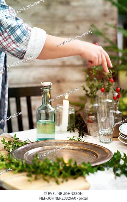 Person preparing table setting