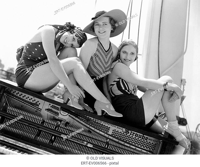 Three women sitting on top of a piano All persons depicted are not longer living and no estate exists Supplier warranties that there will be no model release...