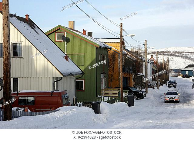 snow covered street of traditional wooden houses in kirkenes finnmark norway europe