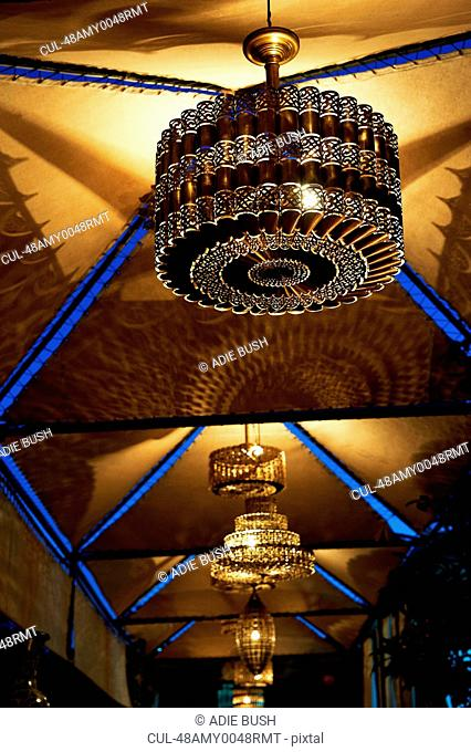 Ornate chandeliers hanging from ceiling