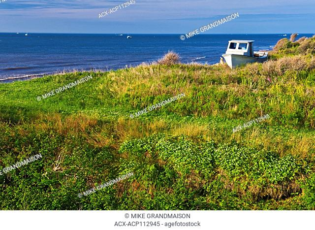 A landed boat on the coastline of Lamèque Island, New Brunswick, Canada