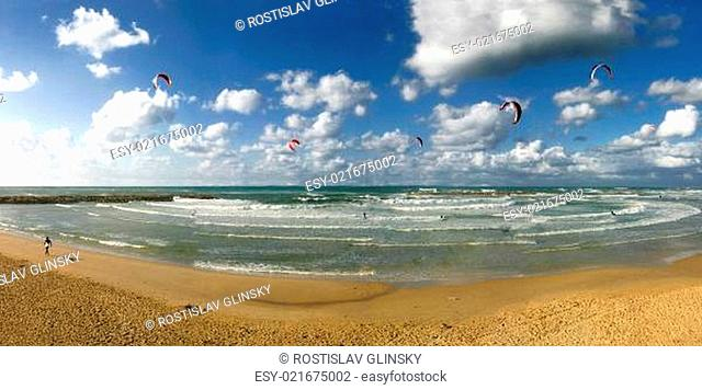Panoramic view on public beach under the beautiful blue sky with white clouds on