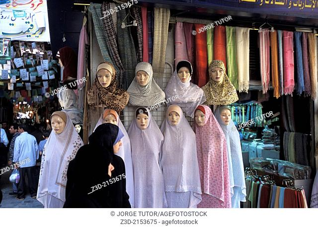 Muslim woman going by at mannequins in Damascus market, Syria