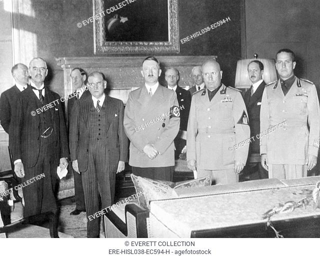 The Munich Conference that ceded the Czech Sudetenland to Germany. Chamberlain, Daladier, Hitler, Mussolini, and Ciano are pictured before the signing
