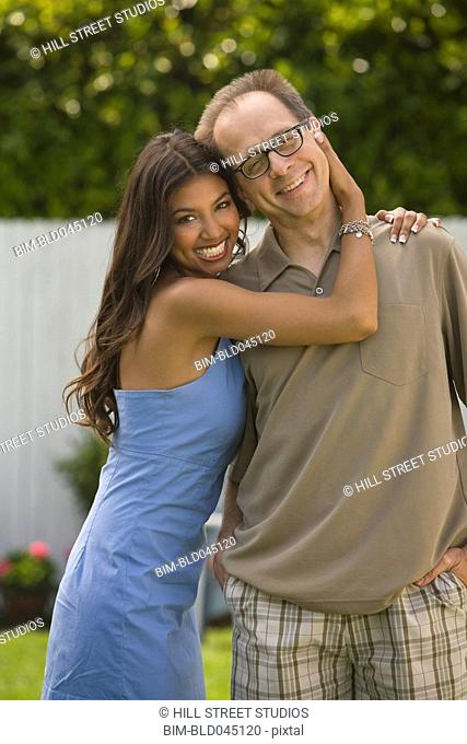 Multi-ethnic couple hugging