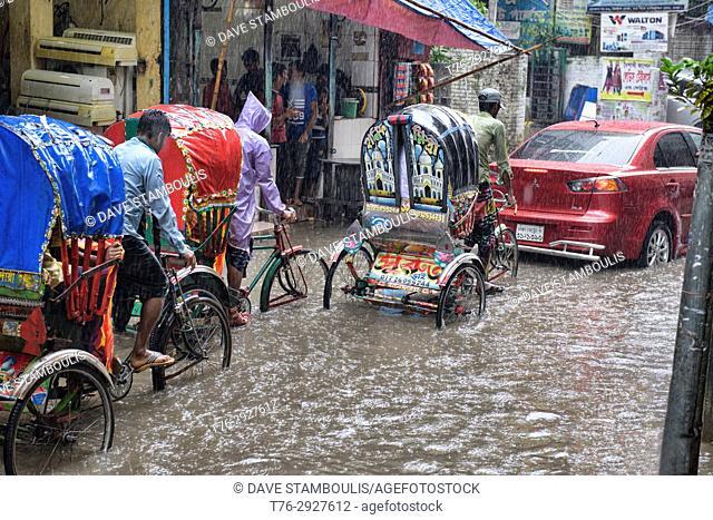 Rickshaws in the monsoon, Dhaka, Bangladesh