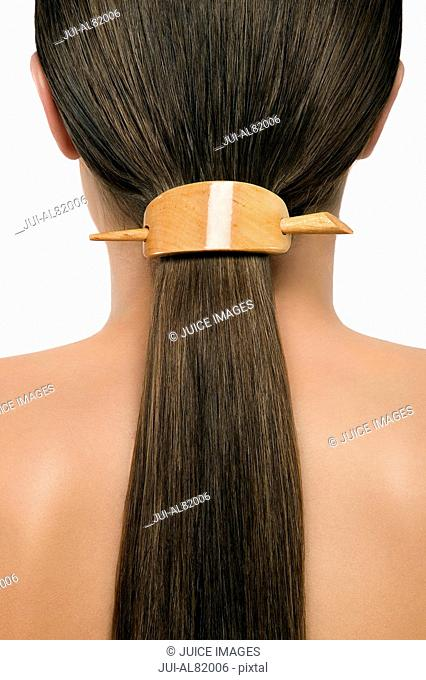 Close up of womanis hair in ponytail with hair accessory