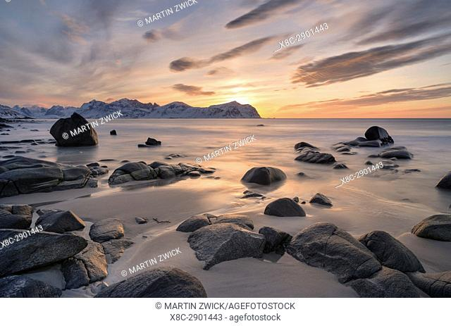 Beach near Vikten on the island Flakstadoya. In the background the mountains of the island Moskenesoya. The Lofoten Islands in northern Norway during winter