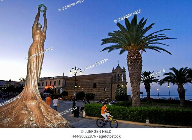 Greece Zakynthos town Platia Solomou sculture background Agios Nikolaos tou Molou church