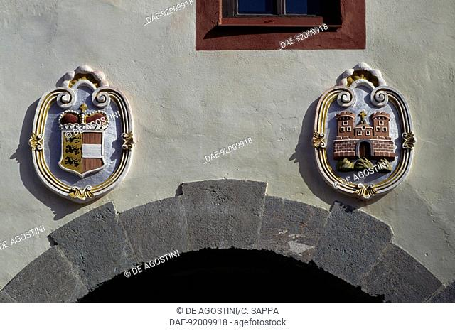 Coats of arms on the facade of the main gate to Gmund in Karnten, Carinthia, Austria