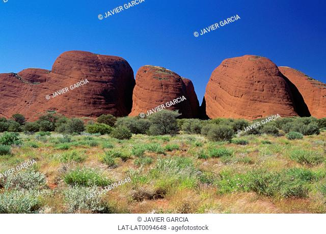 Kata Tjuta,also known as Mount Olga or colloquially as The Olgas,are a group of large domed rock formations located about 365 km southwest of Alice Springs