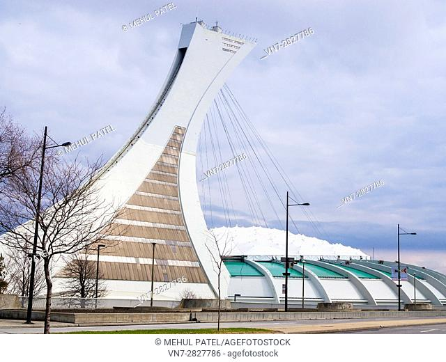 Montreal Tower and Olympic Stadium - Montreal, Canada. Built for the 1976 Summer Olympic Games, the Olympic stadium is the centrepiece of the Olympic Park