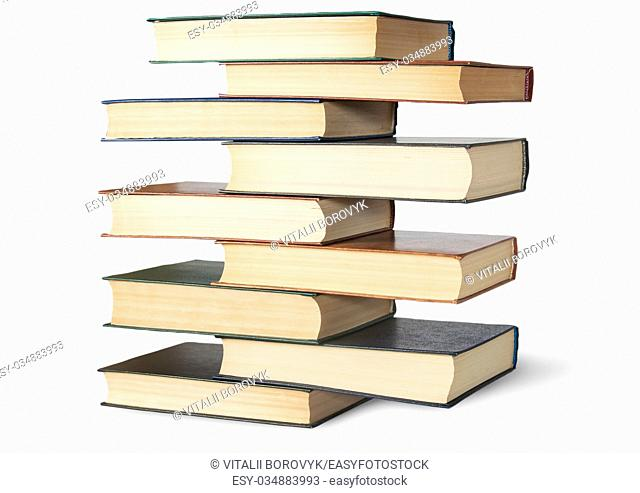 Vertical stack in old books rotated isolated on white background